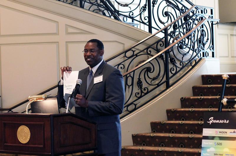 2012 HCAC Brilliance  Awards: Bryan Umstead, Sr. Coordinator Diversity Business Development, Progress Energy, presenting award for Partner of the Year.