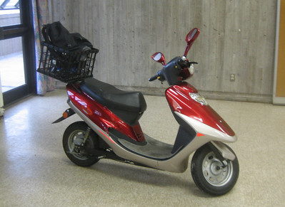 I rode an electric scooter to campus, in spite of the cold day,.
