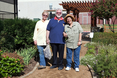 Pam, Chuck, and Martha - in the garden.