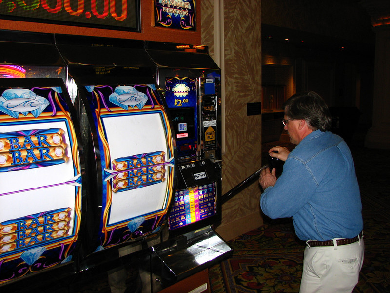 Dave tries his luck at the huge slot machine. He lost and is still employed at SunGard HE.