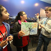 NETSCOUT and Shooting Stars Foundation host Star-Hacks on for middle and high school students. From left, Harshitha Simhadri, 11, of Westford, Trisha Manda, 11, of Ashland, and volunteer Carter Aubrey, 17, of Leominster, a senior at St. John's in Shrewsbury who works for Code Wiz. (SUN Julia Malakie)