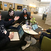 NETSCOUT and Shooting Stars Foundation host Star-Hacks on for middle and high school students. From left, Nashoba Tech sophomores Mike Carpenter and Georgia Sarrategui of Chelmsford, Newton North junior Lasya Thavanati, and Nashoba Tech freshman Rajin Kichannagari of Chelmsford, work on Blue Heart, an app/device to wear on the wrist and send an alert via Bluetooth if the wearer's heart rata goes above or below their healthy range. (SUN Julia Malakie)