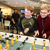 NETSCOUT and Shooting Stars Foundation host Star-Hacks on for middle and high school students. Jack Whitman, left, and Pavel Belakurski, both 12 and from Blanchard Middle School in Westford, play table soccer during an hourly break. (SUN Julia Malakie)