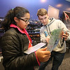 NETSCOUT and Shooting Stars Foundation host Star-Hacks on for middle and high school students. Trisha Manda, 11, of Ashland, gets advice from volunteer Carter Aubrey, 17, of Leominster, a senior at St. John's in Shrewsbury who works for Code Wiz. (SUN Julia Malakie)