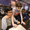 NETSCOUT and Shooting Stars Foundation host Star-Hacks on for middle and high school students. From left, Ayush Mitra, 13, of Chelmsford, Austin Leiwant, 13, of Westford, and Oliver Rodriguez, 13, of Shirley, work on Smrt-Wat3r, an app for finding the nearest water fountain and telling it how much to fill your bottle. (SUN Julia Malakie)