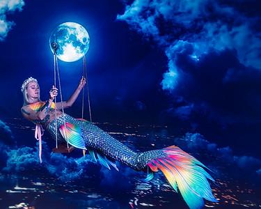 Mermaid swinging on the moon