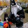 Record-Eagle/Keith King<br /> Katie Venhuizen, bottom left, 6, dressed as a mermaid, and her brother Luke Venhuizen, 7, dressed as Luke Skywalker, receive candy from John Zaloudek, dressed as a wizard, Monday, October 31, 2011 in Traverse City.