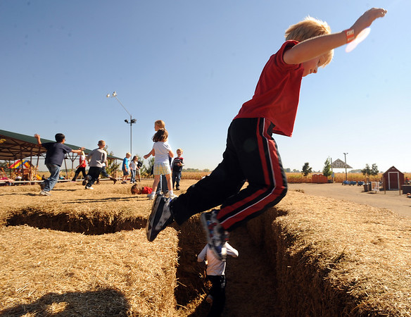 "Jack Dulaigh, 5, of Parker, jumps from bail to bail at the new hay maze at Anderson Farms, which has several Halloween activities.<br /> For more photos and a video of Anderson Farms, go to  <a href=""http://www.dailycamera.com"">http://www.dailycamera.com</a>.<br /> Cliff Grassmick / October 7, 2010"