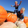 "Jackson Moore, 5, left, and Liviana Klisis, 4, play on the giant pumpkins at Anderson Farms. There are several Halloween activies at the Erie farm.<br /> For more photos and a video of Anderson Farms, go to  <a href=""http://www.dailycamera.com"">http://www.dailycamera.com</a>.<br /> Cliff Grassmick / October 7, 2010"