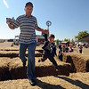 "Peter Lendel and his son, Merrick, 3, race around the hay bails at Anderson Farms on Thursday.<br /> For more photos and a video of Anderson Farm, go to  <a href=""http://www.dailycamera.com"">http://www.dailycamera.com</a>.<br /> Cliff Grassmick / October 7, 2010"