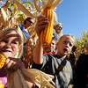 "Emma Bacon, left, explores the Anderson Farms corn maze with her classmates from Tarver Elementary of Thornton.<br /> For more photos and a video of Anderson Farms, go to  <a href=""http://www.dailycamera.com"">http://www.dailycamera.com</a>.<br /> Cliff Grassmick / October 7, 2010"