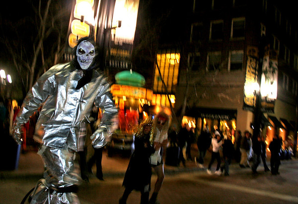 Jay Haas walks across Broadway Street on the Pearl Street Mall on Halloween night. <br /> Photo by Will Morgan/ For The Camera