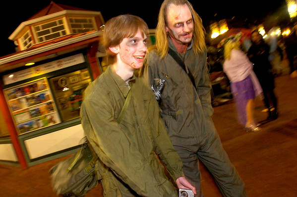 Trevor Aldridge, at left, and his dad John work their scary way through the crowd on the Pearl Street Mall Halloween evening.<br /> Photo by Paul Aiken