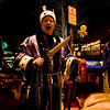 "Alex Cassidy, of Boulder, ""knights"" two others on the Pearl Street Mall on Halloween night, Oct. 31, 2009.  <br /> KASIA BROUSSALIAN / THE CAMERA"