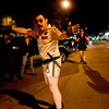 Dressed as a police officer, Mike Persopio, of Boulder, pretends to direct traffic on Pearl Street on Halloween night, Oct. 31, 2009.  <br /> KASIA BROUSSALIAN / THE CAMERA