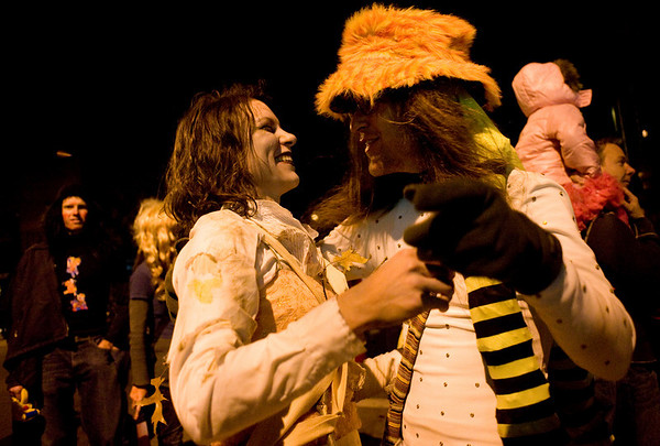 Lea Yancey, of Boulder, (left) hugs Brian Keith, also of Boulder, while celebrating on the Pearl Street Mall on Halloween night, Oct. 31, 2009.  <br /> KASIA BROUSSALIAN / THE CAMERA