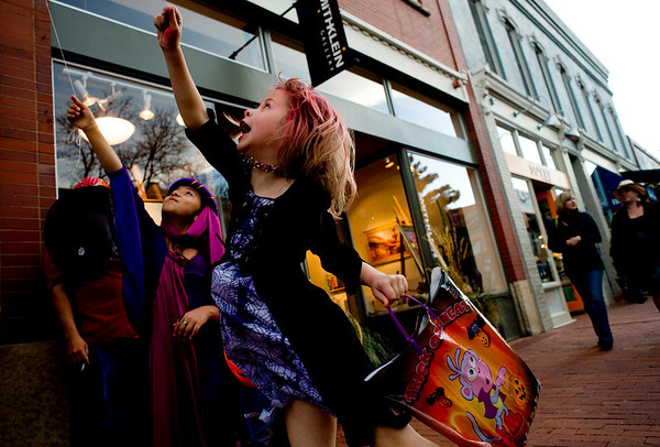 Alondra Chanez, 6, (right) and her cousin Jaqueline Chanez play with their balloons while trick-or-treating on the Pearl Street Mall on Halloween night, Oct. 31, 2009.  <br /> KASIA BROUSSALIAN / THE CAMERA
