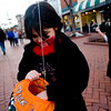 Kaelei Barker, 8, (left) looks through her bag of candy while her friend Tehya Bhotia, 7, runs to catch up on the Pearl Street Mall on Halloween night, Oct. 31, 2009.  <br /> KASIA BROUSSALIAN / THE CAMERA
