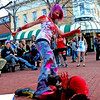 Caitlin Foster and Adrian Gomez, dressed as zombies, play fight on Pearl Street on Halloween as an audience forms around them. Will Morgan
