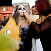 Alana Young-Morrison, 12, (right) feeds a sucker candy to Reanna Magruder, 11, while trick-or-treating on the Pearl Street Mall on Halloween night, Oct. 31, 2009.  <br /> KASIA BROUSSALIAN / THE CAMERA