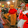 From left, Ali Alyousifi, Claudia Hodges and Conrad Gonzales watch as a woman hugs Greg Dobbin on Halloween on the Pearl Street Mall in Boulder. <br /> Photo by Will Morgan/ For The Camera