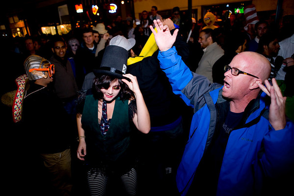 "People dance to drums in front of Old Chicago on the Pearl Street Mall on Halloween night, Oct. 31, 2009.  Thousands showed up to bring back the ""Mall Crawl"".<br /> KASIA BROUSSALIAN / THE CAMERA"