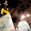 Matt Reid, of Boulder, climbs the ornamental rock on the Pearl Street Mall on Halloween night, Oct. 31, 2009.  <br /> KASIA BROUSSALIAN / THE CAMERA