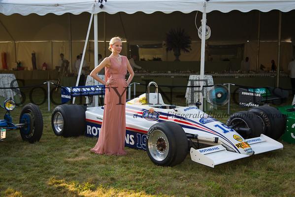 Elena posing with a Rothmans/Newsweek Formula One Race Car