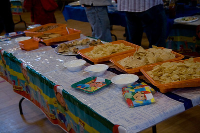 one of the food tables with chips, dips, etc in paint trays