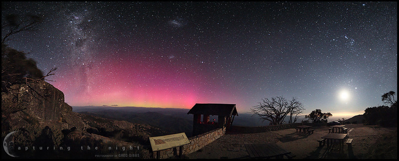 "Photography by © Greg Gibbs - ""Lookout"" - Aurora Australis, Mount Buffalo National Park, Australia. 17th of March 2013. This is the lookout below ""The Horn"" in the Mount Buffalo National Park. Over 180 degree panorama made from 8 portrait style images. The landscape is being lit by the light of the crescent moon which is the bright spot on the right of this image. Another one of my cameras is in the hut doing a time-lapse.<br /> <a href=""http://500px.com/CapturingTheNight"">http://500px.com/CapturingTheNight</a>"