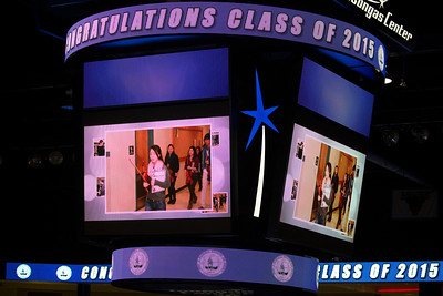 The central TV screens show scenes from the year at Lexington High.