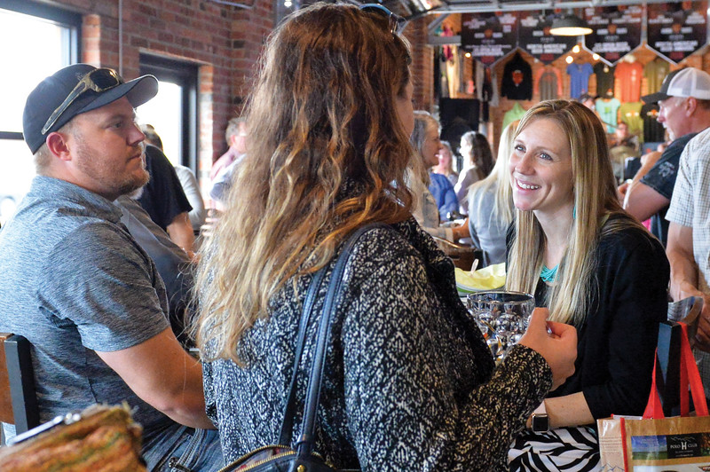 Ashleigh Fox | The Sheridan Press<br /> Paige Sanders, a 20 Under 40 Class of 2018 honoree, speaks with friends during The Sheridan Press 20 Under 40 Happy Hour Monday, June 18, 2018.