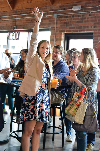 Ashleigh Fox | The Sheridan Press<br /> Polly Burge, a 20 Under 40 Class of 2018 honoree, raises her hand in acknowledgement of her honor during The Sheridan Press 20 Under 40 Happy Hour Monday, June 18, 2018.