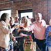 Ashleigh Fox | The Sheridan Press<br /> A group cheers in honor of Polly Burge, left, a 20 Under 40 Class of 2018 honoree, during The Sheridan Press 20 Under 40 Happy Hour Monday, June 18, 2018.