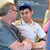 Ashleigh Fox | The Sheridan Press<br /> Tyler Rogers, a 20 Under 40 Class of 2018 honoree, speaks with a friend during The Sheridan Press 20 Under 40 Happy Hour Monday, June 18, 2018.