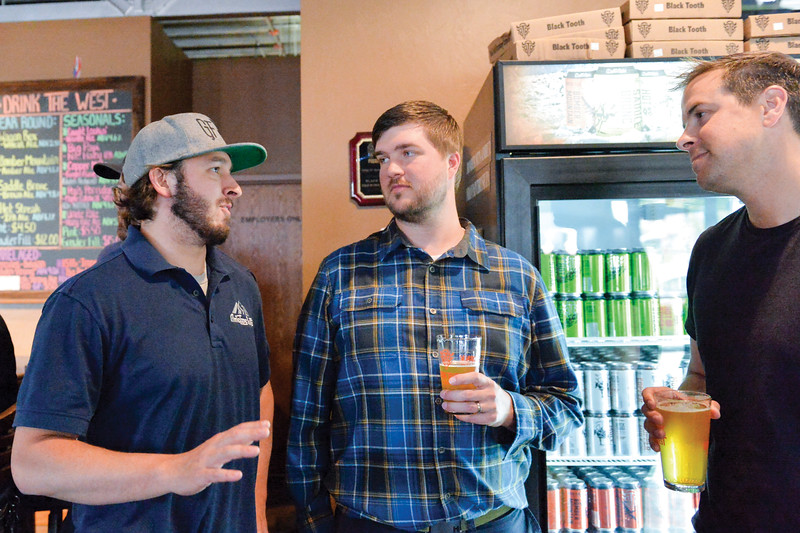Ashleigh Fox | The Sheridan Press<br /> Brett Riley (left), a former 20 Under 40 honoree, speaks with former honoree Josh Law and Casey Osborn, a 20 Under 40 Class of 2018 honoree during The Sheridan Press 20 Under 40 Happy Hour Monday, June 18, 2018.