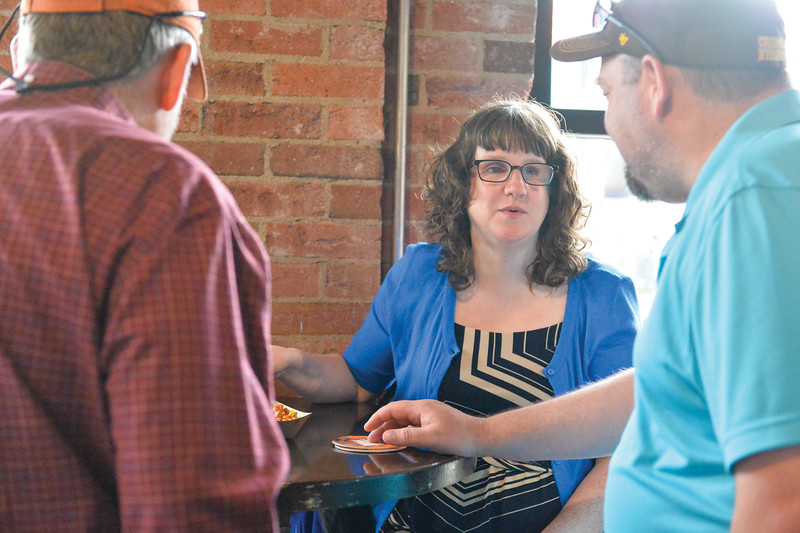 Ashleigh Fox | The Sheridan Press<br /> Billie Chapman, a 20 Under 40 Class of 2018 honoree, speaks with friends during The Sheridan Press 20 Under 40 Happy Hour Monday, June 18, 2018.