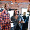Ashleigh Fox | The Sheridan Press<br /> Spencer Kuzara, right, a 20 Under 40 Class of 2018 honoree, speaks with Brady Adams and Kassi Trujillo-Sullivan during The Sheridan Press 20 Under 40 Happy Hour Monday, June 18, 2018.