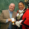 Outgoing Mayor Councillor Alan Dobbie receives his badge of office for serving as Mayor from Mayor Councillor Bernice Vanier