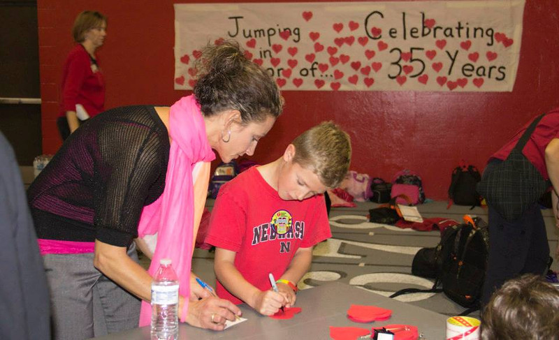 Tricia and Broc Berry sign up for Jump Rope for Heart Wednesday in the Nelson Physical Activity Center. (Tena L. Cook/ Chadron State College)