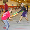 CSC student athlete Dustin Stodola plays a game of pool noodle tag with one of many Jump Rope for Heart participants Wednesday in the Nelson Physical Activity Center. (Tena L. Cook/ Chadron State College)