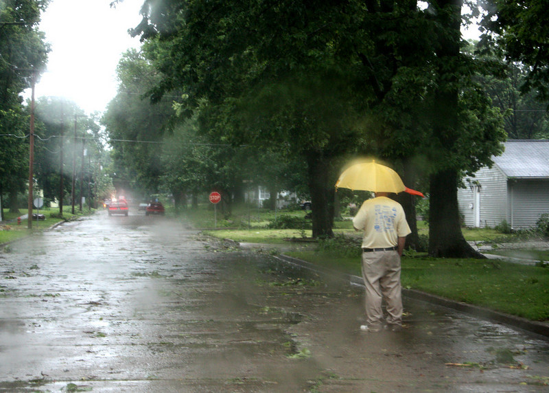 I photographed this through the windshield of my car.  Some guy was looking at the action with a Donald Duck umbrella.