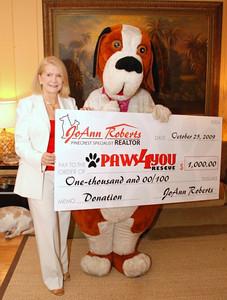 Buddy graciously accepting JoAnn Roberts' donation check.
