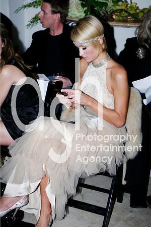 Paris Hilton texting during fashion show