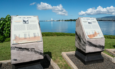 Two monuments of the Submarine Memorial, with the Missouri and Arizona in the distance