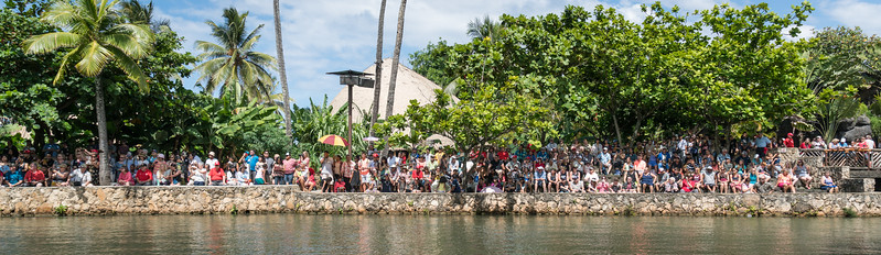 Spectators assembled for the Pageant of Long Canoes.  Many red shirts in the crowd.