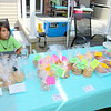 The family of Connor Joshua McKenna held a bake sale and lemonade stand on Saturday to buy a headstone for him. Connor's younger brother Tucker Mitton, 10, manned the stand during the fundraiser. SENTINEL & ENTERPRISE/JOHN LOVE