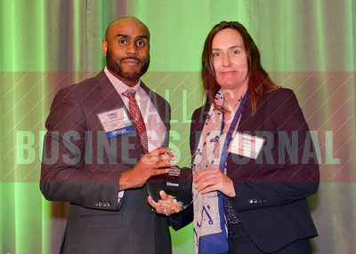 Presenting sponsor, Tyrell Hughes from Cancer Centers of America with Ericsson #17 Healthiest Employers in north Texas.