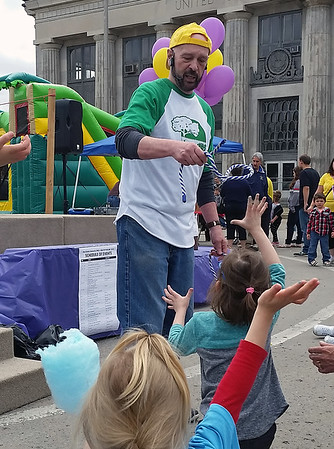 Freddie Pettet, children's pastor at First Assembly of God, picks a volunteer from the audience for a rope trick that was part of his magic/ventriloquism show at Y Healthy Kids Day.