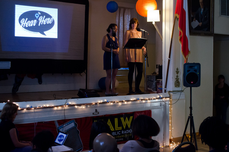 Erica Mu and Audrey Dilling on stage with audience. KALW Mission Arts and Performance Project (MAPP) June 2012, The Polish Club, 3040-22nd St. at Shotwell St., Mission district, San Francisco, California.
